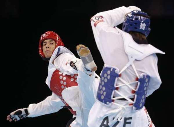 Steven Lopez, left, fights Azerbaijan's Ramin Azizov.