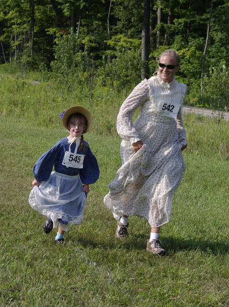 Kim LaVictor of Levering (right) runs the 1-mile Fun Run with her niece, Bridgette Peurasaari, also of Levering, at the Historic Festival on Saturday in Mackinaw City.