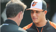 One minute this week Manny Machado was the baron of Bowie, traveling with the Baysox to glamorous ports of call like Altoona. And the next -- he's in Baltimore, pulling on a pristine new Orioles uniform.