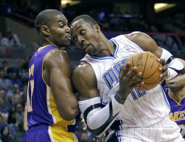 Orlando's Dwight Howard, right, pushes past Andrew Bynum during the second half of a Jan. 20 game.