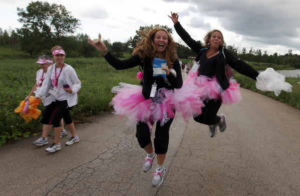 Trisha Zubert, center, and Mollie Lard, right, participate in the three-day walk.
