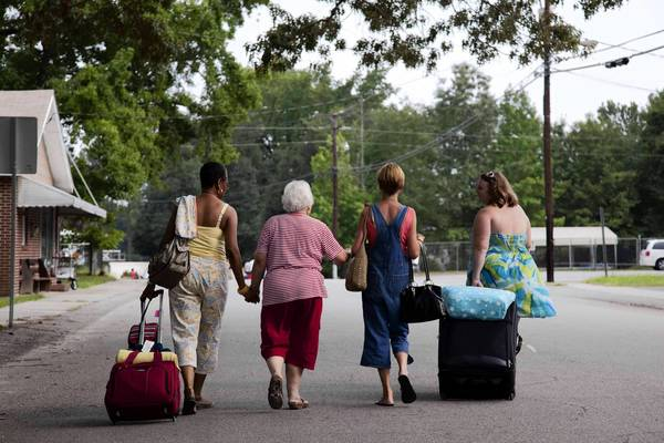 "The women of Yemassee, SC, walk to the train in the Lifetime series ""The Week the Women Went."""