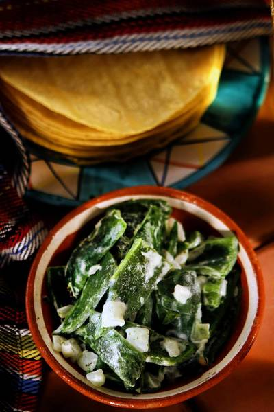 Rajas con crema is charred poblano pepper strips with cream.
