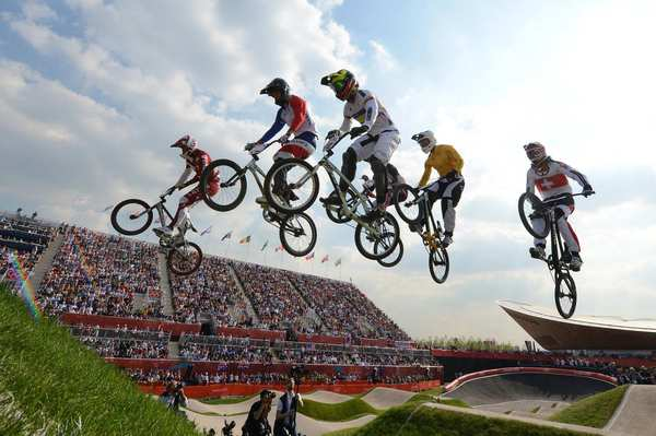 Lativia's Maris Strombergs, left, France's Joris Daudet, Colombia's Carlos Mario Oquendo Zabala, Australia's Sam Willoughby and Switzerland's Roger Rinderknecht take a jump during the BMX cycling men's semifinals event. Strombergs went on to win gold (his second straight) in the final.