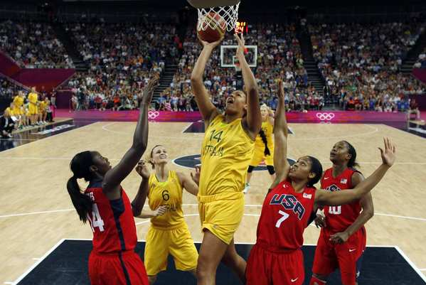 Australia's Liz Cambage  shoots over Maya Moore, right, and Tina Charles of the United States in their semifinal match.