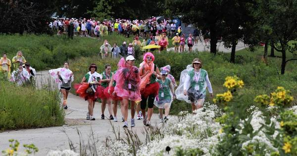 Walkers wind through the foliage of Chicago Botanic Garden in Glencoe. The 60-mile walk began in Northbrook and finishes Sunday at Soldier Field.