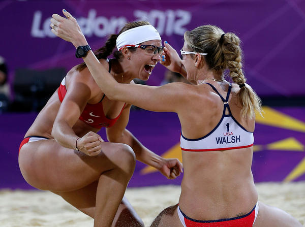 Misty May-Treanor and Kerri Walsh Jennings celebrate winning their third Olympic gold medal in Women's Beach Volleyball on Aug. 8 in London.