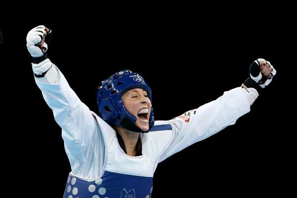 Jade Jones of Great Britain celebrates her defeat of Yuzhuo Hou of China in the women's 57kg taekwondo gold medal final.