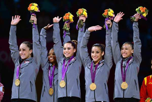 USA gymnasts, from left, Jordyn Wieber, Gabrielle Douglas, McKayla Maroney, Alexandra Raisman and Kyla Ross celebrate their gold medal in the women's team final.