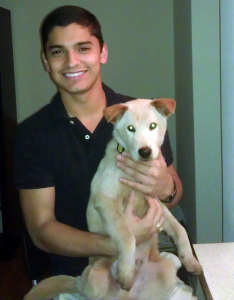 "Derek Fierro holds ""Doc"" at Chicago Canine Rescue Foundation in October 2011 when he adopted the dog. Fierro is charged with aggravated cruelty to animals, a felony, police said, for allegedly punching the dog to death."