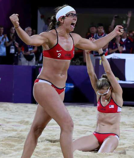 Misty May-Treanor, left, and Kerri Walsh Jennings celebrate seconds after winning their third straight gold medal in beach volleyball.
