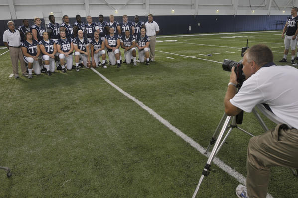 Photographer Stephen Slade, of Tolland, photographs, the offense during media day. The UCONN Football team held its media day at the Shenkman Center in Storrs, CT. Coach Paul Pascualoni and other players were in attendance.