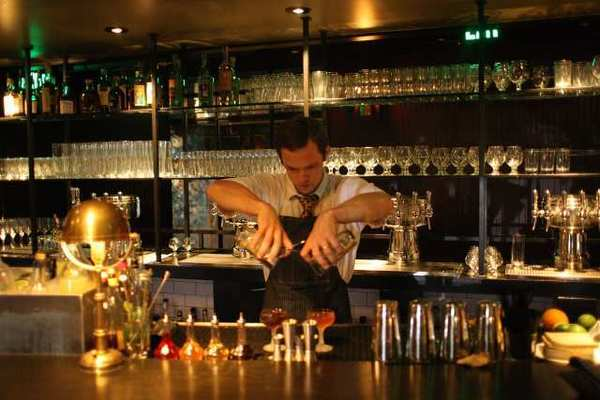 Mixologist John Coltharp pours at the Parish, a new downtown gastropub by Tasting Kitchen chef Casey Lane.