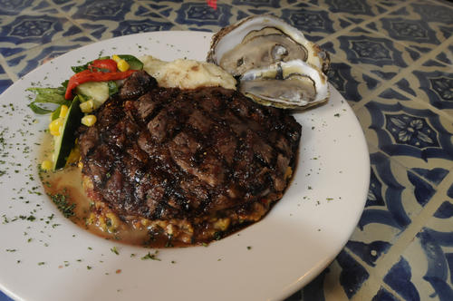 The Naked Oyster's grilled rib-eye with oyster, stuffing and port wine reduction, paired with the freshest oysters of the day.