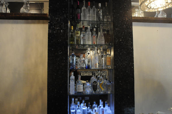 The bar at The Naked Oyster Cocktail Eatery carries more than 100 vodkas.