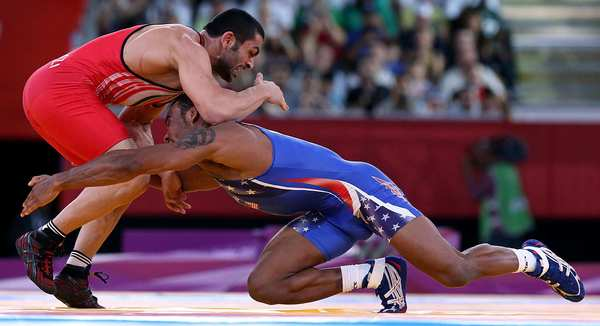 U.S. wrestler Jordan Burroughs keeps the pressure on Iran's  Sadegh Saeed Goudarzi.