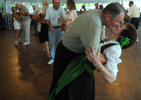 erome Tannery of Bethlehem Township gives his wife Trudi a big dip and a kiss after dancing to the music of the Adlers at Festplatz Friday afternoon.