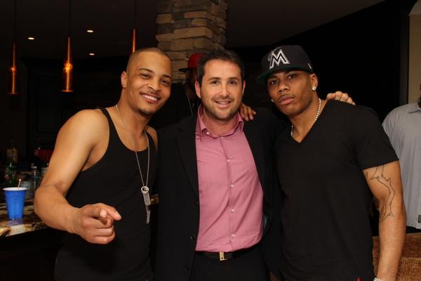 Brian Sher with his business partner and client, T.I. (left) and the rapper Nelly (right) in Atlanta at a party hosted by T.I.