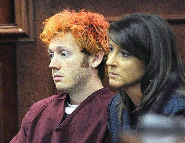 James Holmes, accused of killing 12 people and wounding 58 in an Aurora, Colo., movie theater, appears last month in Arapahoe County District Court with defense attorney Tamara Brady.