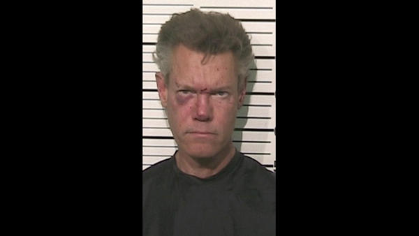 Mug shots of the rich and infamous: Randy Travis is bruised up in a mug shot taken after he was arrested Aug. 8, 2012, on suspicion of DWI and a third-degree felony count of retaliation. He was naked when he was arrested.