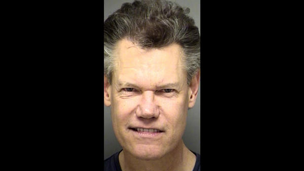 Mug shots of the rich and infamous: Randy Travis was arrested Feb. 6, 2012, on a charge of public intoxication. He was parked at a Baptist church, allegedly smelling of alcohol with an open bottle of wine in the front seat of his Trans Am.