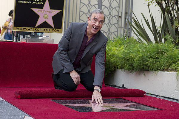 US singer-songwriter Neil Diamond receives a star on the Hollywood Walk of Fame, outside the Capitol Records Building in Hollywood, California, on August 10, 2012. Diamond, whose career has spanned five decades from the 1960's to the present, is considered one of the most successful adult contemporary artists ever according to the Billboard chart.