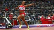 Carmelita Jeter of the United States celebrates winning gold in the Women's 4 x 100m Relay Final on Day 14 of the London 2012 Olympic Games