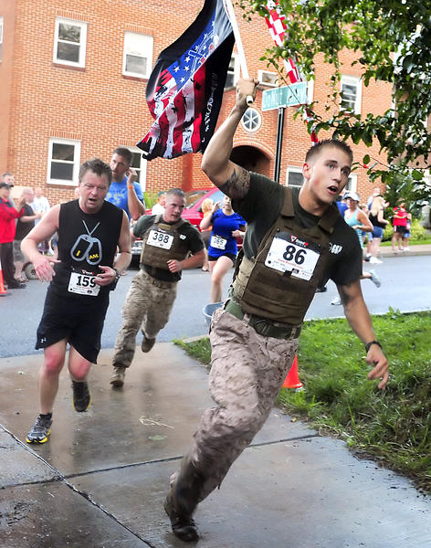 Marine Cpl. Kevin Ecke of Hagerstown runs toward the finish line in the Krumpe's Do-Nuts Alley Rally 5K benefiting the Wounded Warriors Project Friday in Hagerstown.