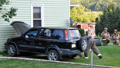 One person was taken to Windber Medical Center after their vehicle crashed into a residence at 152 Richland Avenue in Scalp Level Borough, Cambria County.