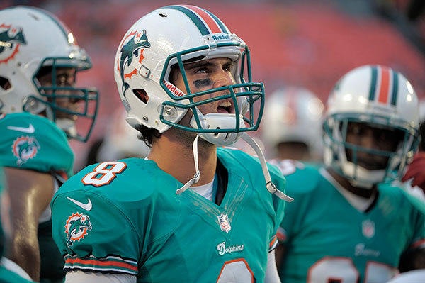 Miami Dolphins quarterback Matt Moore looks up at the score board during the first half of their preseason game against the Tampa Bay Buccaneers, Friday, August 10, 2012, at Sun Life Stadium.