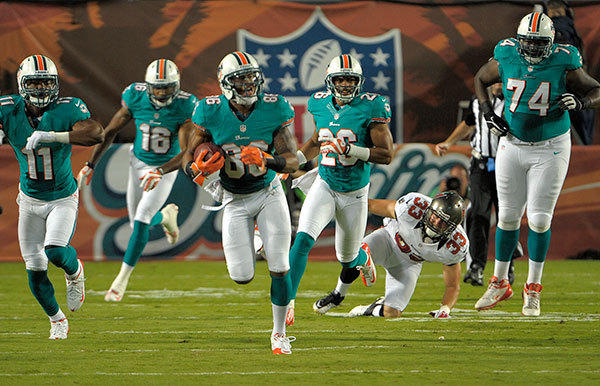 Miami Dolphins receiver Rishard Matthews runs in the open field after catching during the second quarter against the Tampa Bay Buccaneers, Friday, August 10, 2012, at Sun Life Stadium.