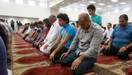 People take part in Friday prayers at the newly opened Islamic Center of Murfreesboro in Murfreesboro, Tenn.