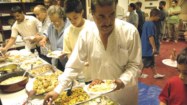 Muslim men line up for the buffet given at the Imperial Valley Islamic Center for the breaking of the fast for the Islamic holy month of Ramadan.