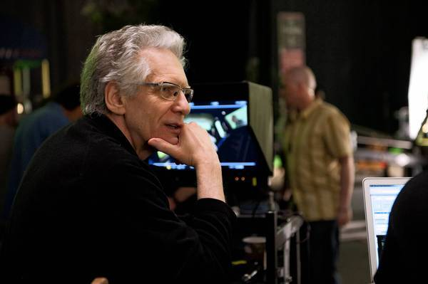"David Cronenberg directing the movie ""Cosmopolis."""