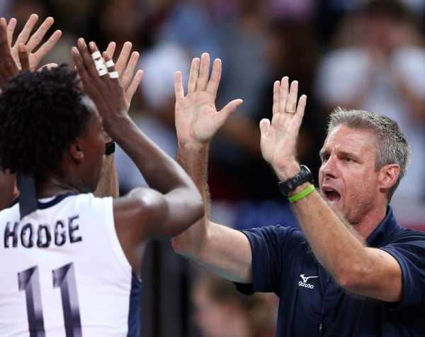 Assistant coach Karch Kiraly of the United States celebrates a win over China with Megan Hodge.