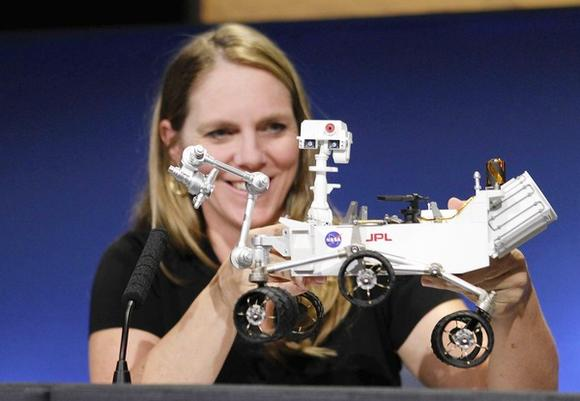 Jennifer Trosper, Mars Science Laboratory mission manager, shows off a model of the Mars rover Curiosity at NASA's Jet Propulsion Lab in Pasadena, Calif.