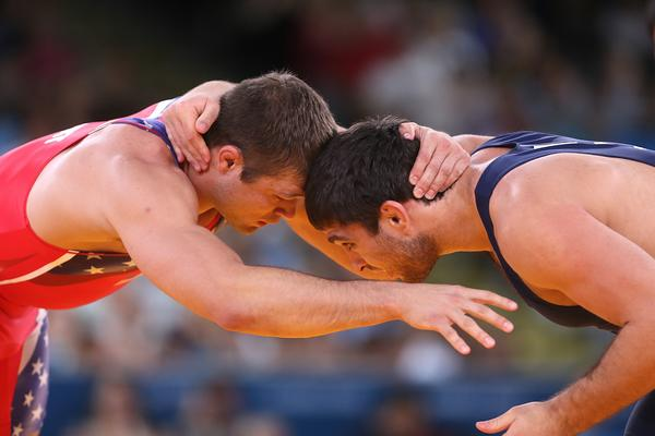 American Jake Herbert (left) wrestles Azerbaijan's  Sharif Sharifov in their Men's 84kg Freestyle quarterfinal match.