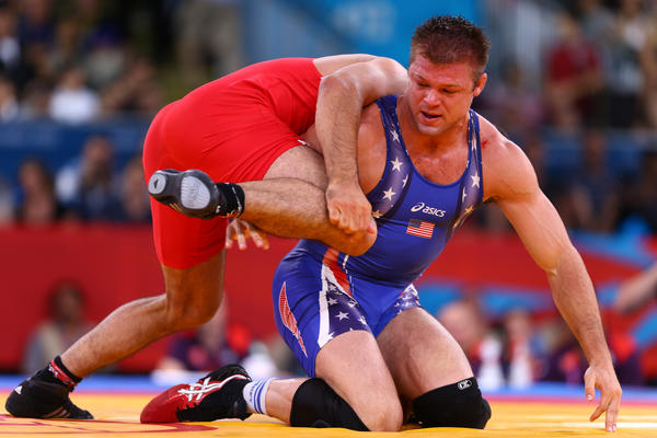 Jake Herbert (blue of the United States competes against Ibrahim Bolukbasi of Turkey in the Men's Freestyle 84 kg Wrestling event.