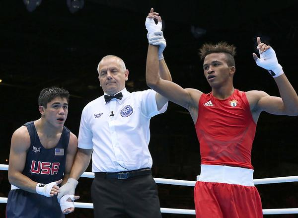 United States' Joseph Diaz Jr. claps for his opponent after losing a decision to Cuba's Lazaro Alvarez Estrada.