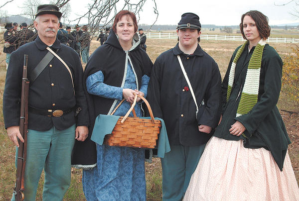June Harris was a reluctant Civil War re-enactor, but eventually participated with her family because her daughter, Sarah, had sewn her two dresses. Pictured in this November 2009 photo are, from left, Kevin, June, Joshua and Sarah Harris.