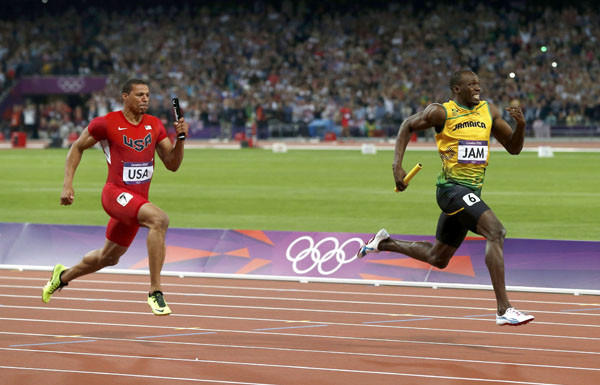 Jamaica's Usain Bolt (R) crosses the finish line in first place in the men's 4x100m relay final ahead of Ryan Bailey of the U.S. (Reuters)