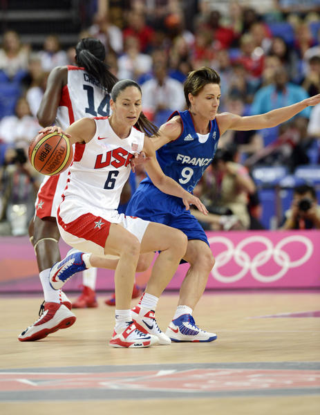 USA guard Sue Bird (6) spins away from France guard Celine Dumerc (9) during the women's basketball gold medal game in the London 2012 Olympic Games at North Greenwich Arena.