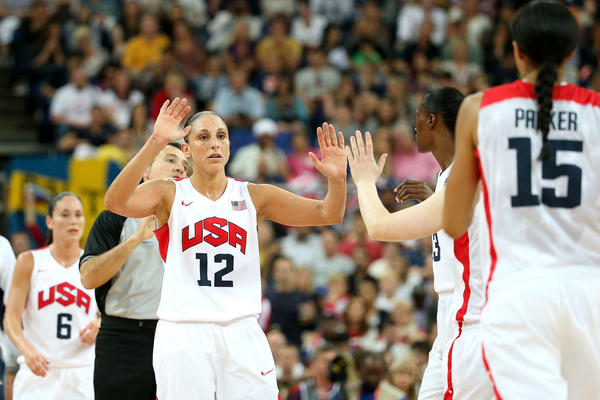 Diana Taurasi #12 of United States celebrates with teammates in the first quarter against France during the Women's Basketball Gold Medal game on Day 15 of the London 2012 Olympic Games at North Greenwich Arena on August 11, 2012 in London, England.