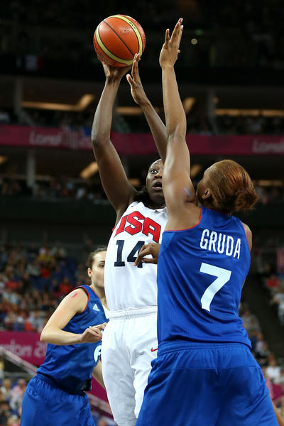 Tina Charles #14 of United States goes up for a shot against Sandrine Gruda #7 of France in the first quarter during the Women's Basketball Gold Medal game on Day 15 of the London 2012 Olympic Games at North Greenwich Arena on August 11, 2012 in London, England.