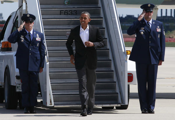 President Barack Obama arrives at O'Hare International Airport today.