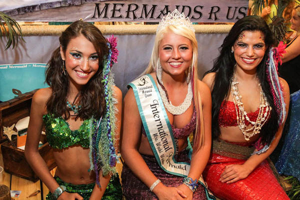Sara Boik, 14, and Jacquelynne Bernstein, 22, model costumes by Mermaids R Us with International Mermaid Queen Kylee Troche, center, during Mer-palooza at the Wyndham Hotel in Orlando, Fla. on Saturday, August 11, 2012.