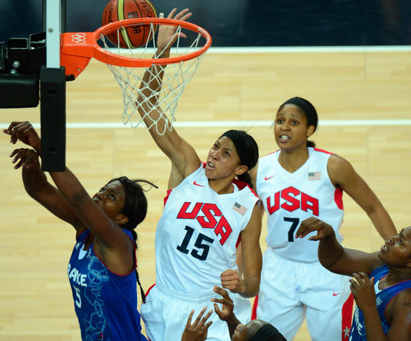 US forward Candace Parker (C) is challenged by French centre Endene Miyem during the London 2012 Olympic Games women's gold medal basketball game between the USA and France at the North Greenwich Arena in London on August 11, 2012