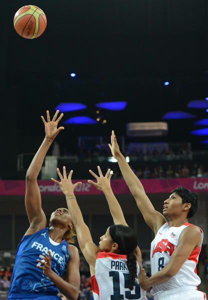 US forward Candace Parker (C) and US guard Angel McCoughtry (R) jump for the ball with French centre Sandrine Gruda during the London 2012 Olympic Games women's gold medal basketball game between the USA and France at the North Greenwich Arena in London on August 11, 2012.