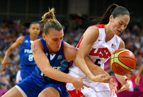 Sue Bird #6 of United States and Marion Laborde #12 of France battle for the ball in the second quarter during the Women's Basketball Gold Medal game on Day 15 of the London 2012 Olympic Games at North Greenwich Arena on August 11, 2012 in London, England.
