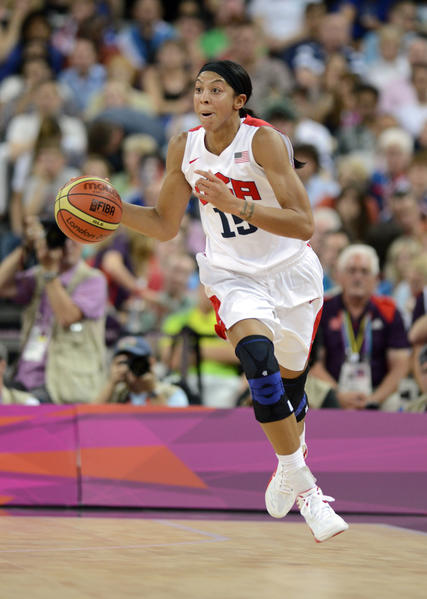 USA forward Candace Parker (15) brings the ball up court against France during the women's basketball gold medal game in the London 2012 Olympic Games at North Greenwich Arena.